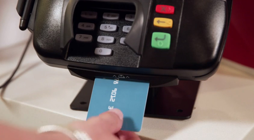 Image of chip card being inserted into chip card terminal reader